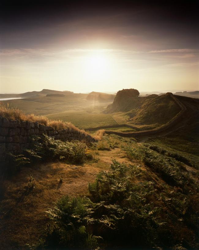 Hadrian's Wall, Northumberland, 2010. View looking east along the wall into bright sunshine, half a mile west of Housesteads Fort. Artist Paul Highnam. (Photo by English Heritage/Heritage Images/Getty Images).