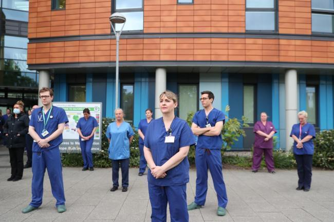NHS staff take part in the silent tribute to fallen colleagues