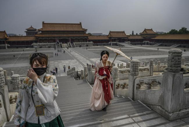 Women dressed in traditional costume known as Hanfu tour the Forbidden City, which recently re-opened to limited visitors, in Beijing, China.