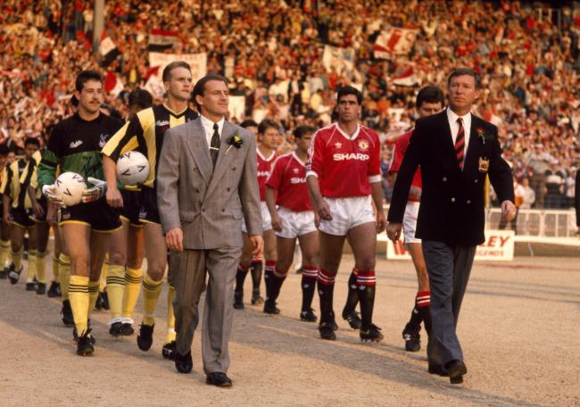 Sir Alex Ferguson leads out his Manchester United team for the 1990 FA Cup final