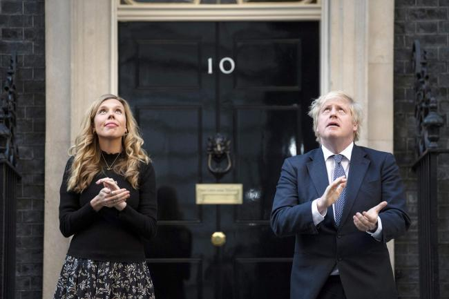 Prime Minister Boris Johnson and Carrie Symonds stand in Downing Street, London, to join in the applause to salute local heroes during Thursday's nationwide Clap for Carers to recognise