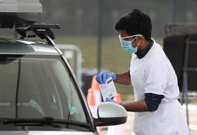 Mitch Wilkins is tested at a drive through testing facility for COVID-19 at Edinburgh Airport as Scotland continues in lockdown to help curb the spread of the coronavirus..