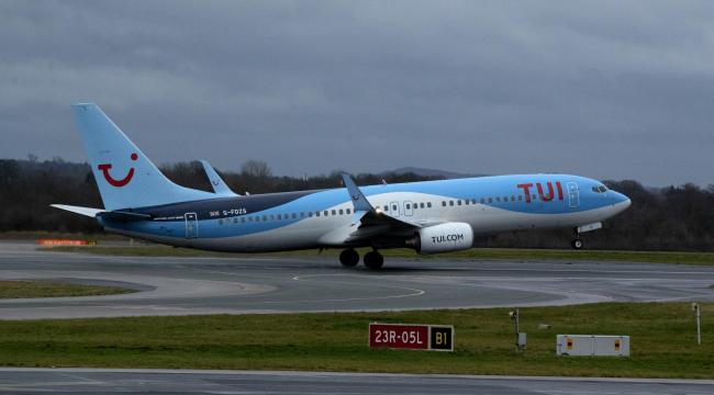 A TUI Boeing 737-8K5 taking off from Manchester Airport (Image: PA)