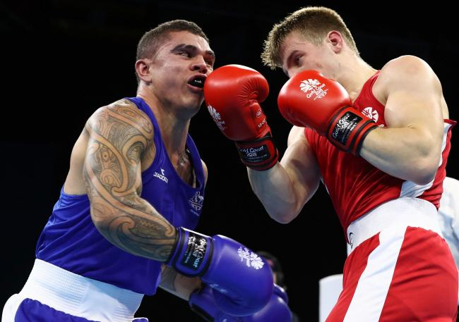 GOLD COAST, AUSTRALIA - APRIL 09:  Clay Waterman of Australia and Sean Lazzerini  of Scotland compete during the MenÕs Light Heavy Preliminary round during Boxing on day five of the Gold Coast 2018 Commonwealth Games at Oxenford Studios on April 9, 20