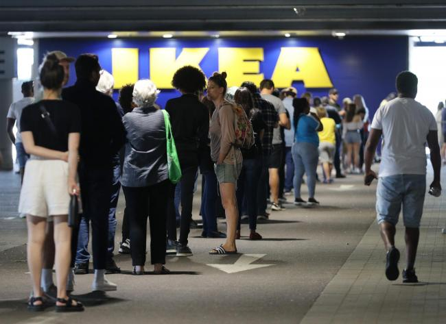 Customers queuing at the IKEA Tottenham store in Edmonton, north London (Image: PA)