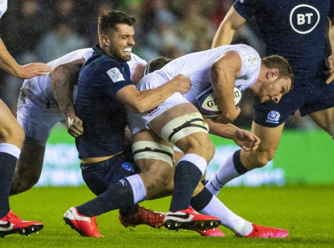 Scotland's Adam Hastings tackles England's Sam Underhill