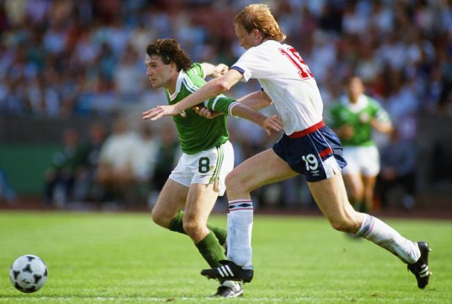 STUTTGART, GERMANY - JUNE 12 : England defender Mark Wright (r) challenges Ray Houghton of Ireland during the European Championships match between Repubic of Ireland and England on June 12, 1988 in Stuttgart, West Germany. (Photo by David Cannon/Allsport/