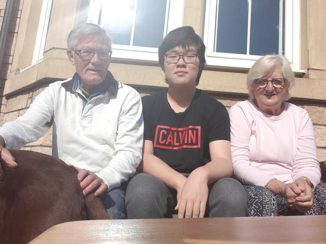 Shirley and Alan Firth, with Chinese student Evan Ren, 16