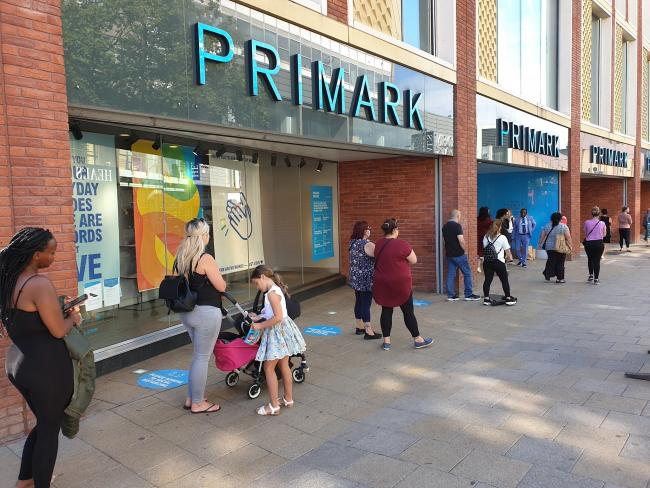 Shoppers queued up outside Primark in Kingston on Monday after England lifted closure orders on non-essential shops