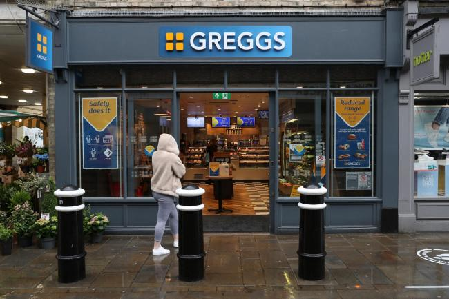 A customer enters a branch of Greggs in Winchester, Hampshire, as the bakery chain reopens 800 stores across the UK following the easing of coronavirus lockdown restrictions. PA Photo. Picture date: Thursday June 18, 2020. See PA story HEALTH