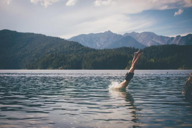 A man diving into a lake, enjoying a wild swimPicture: iStock/PA