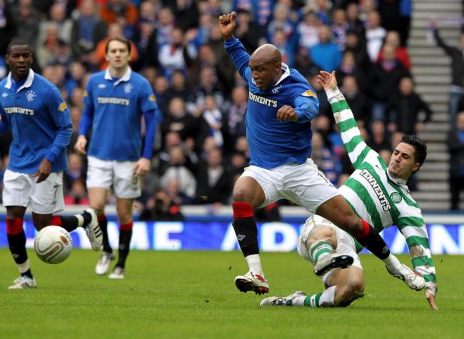 Rangers El-Hadji Diouf is challenged by Celtics Beram Kayal (right) during the Scottish Cup Fifth Round match at Ibrox Stadium, Glasgow in February 6, 2011