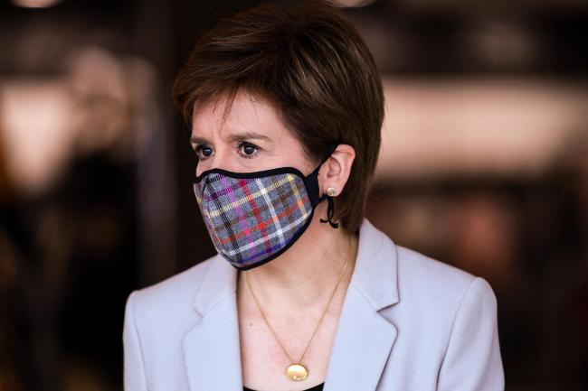 Nicola Sturgeon has called on Scots to wear face coverings in shops