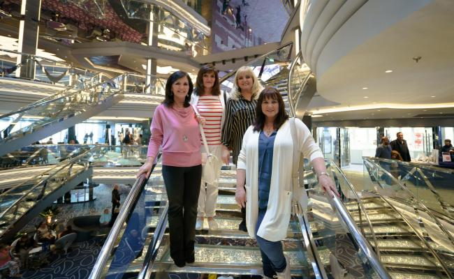The Nolans Go Cruising, Maureen, Anne, Linda, Coleen on the Swarvoski stairs on the cruise ship