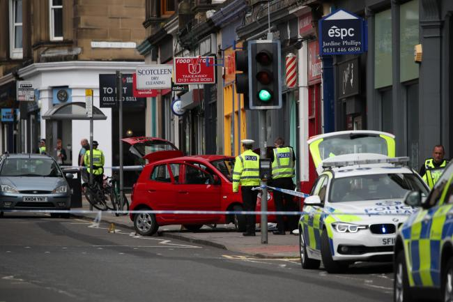 Mother and child  injured after car mounts pavement in Edinburgh