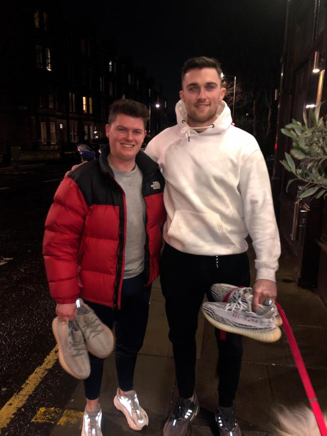 Euan Bodie of Shoefix with Heart of Midlothian football club player John Souttar, who has used the firm's trainer cleaning service
