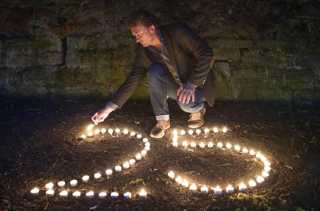 BAFTA award-winning film director Samir Mehanovic, who came to the UK as an immigrant from the Bosnian war in 1995 and now lives in Edinburgh, lights candles to commemorate the 25th anniversary of the Srebrenica genocide. PA Photo. Picture date: Thursday