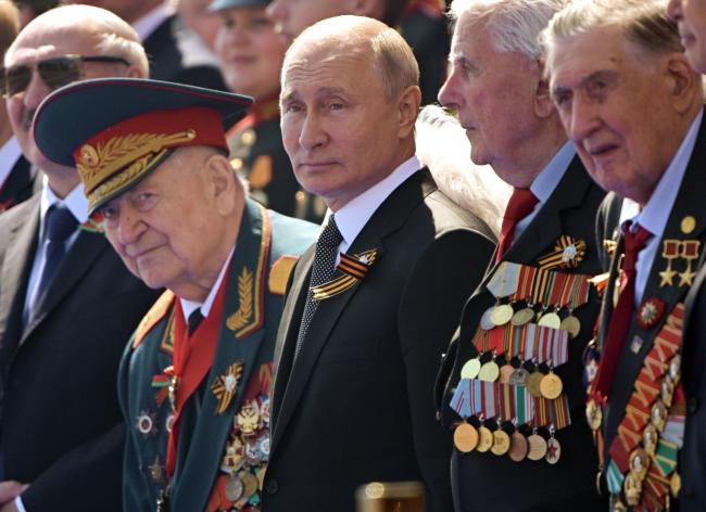 Wednesday, June 24, 2020, Russian President Vladimir Putin, centtr, watches the Victory Day military parade marking the 75th anniversary of the Nazi defeat in Moscow.