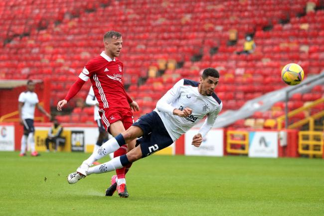 Leon Balogun of Rangers, right, challenges Bruce Anderson of Aberdeen at Pittodrie.