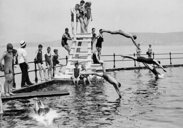 HeraldScotland: Bathers at Gourock's outdoor pool (Photo: Scran)
