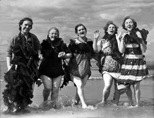 HeraldScotland: Mothers and grannies enjoying a seaweed hula dance at Seton Sands in 1958 (Photo: Scran)