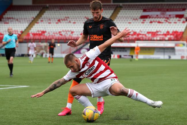 Hamilton Academical's Scott Martin, left, and Rangers' Borna Barisic on Saturday. Photo: Jane Barlow/PA Wire.