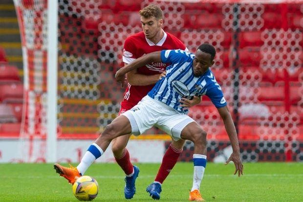 Tommie Hoban, pictured with Kilmarnock's Nicke Kabamba, believes the Dons' early season form will serve them well on Thursday
