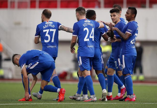 Jermain Defoe of Rangers (hidden) celebrates with teammates after scoring his team's fourth goal during the UEFA Europa League second qualifying round match between Lincoln Red Imps and Rangers at Victoria Stadium