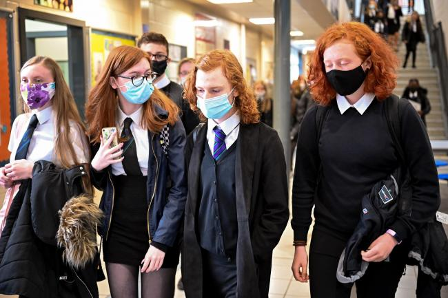 GLASGOW, SCOTLAND - AUGUST 31: Pupils at Rosshall Academy wear face coverings as it becomes mandatory in corridors and communal areas on August 31, 2020 in Glasgow, Scotland. New rules starting today require children over 12 to wear face coverings in corr