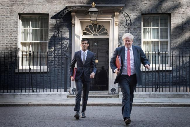 Rishi Sunak and Boris Johnson have performed u-turns over continuing job support and the return to offices Picture: Stefan Rousseau/ PA