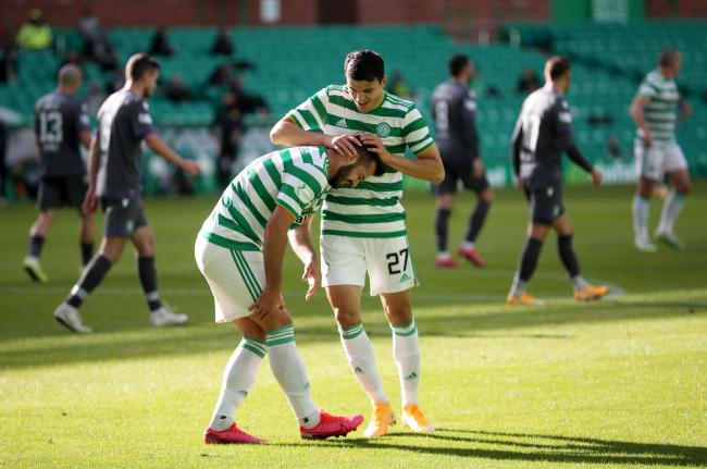 Albian Ajeti, left, celebrates scoring against Hibernian with his Celtic team mate Mohamed Elyounoussi. Photo: Jane Barlow/PA Wire.