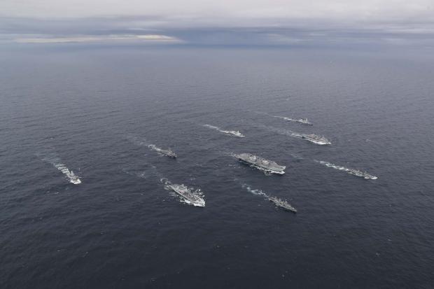 HeraldScotland: HMS Queen Elizabeth and her Carrier Strike Group. Picture: LPhot Belinda Alker, royalnavy.mod.uk