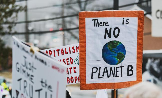 Climate change protestors hold their placards high..