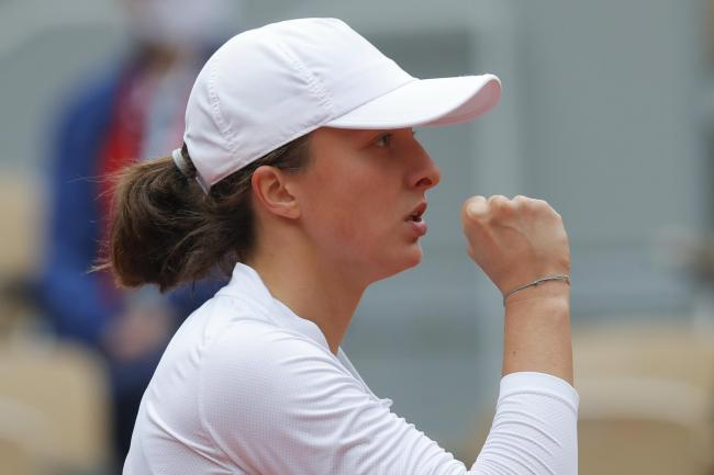 Iga Swiatek clenches her fist during her semi-final victory over Nadia Podoroska