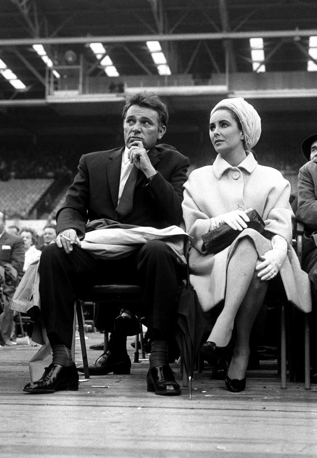Elizabeth Taylor and Richard Burton stars of the film 'Cleopatra', at the ring side at Wembley, London