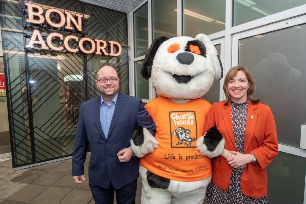 HeraldScotland: (left to right): Craig Stevenson, Bon Accord manager, Charlie House mascot, Susan Crighton, Director of Fundraising for Charlie House.