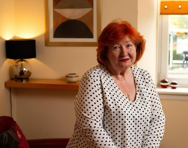 Helene Fitzgerald (pictured at home in Glasgow) has severe COPD, heart problems and walking difficulties, but discovered getting to her vaccination hub would require four separate buses