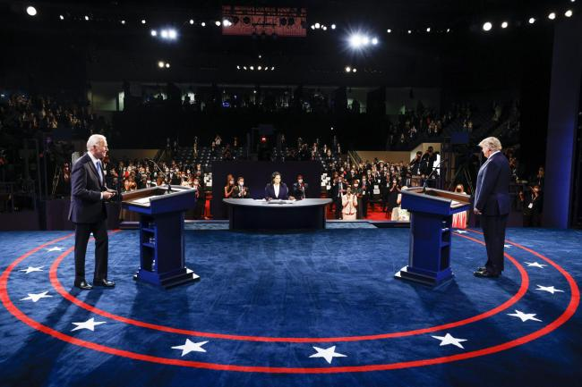 President Donald Trump and Democratic presidential candidate former Vice President Joe Biden participate in the final presidential debate at Belmont University, Thursday, Oct. 22, 2020, in Nashville, Tenn. (Jim Bourg/Pool via AP)