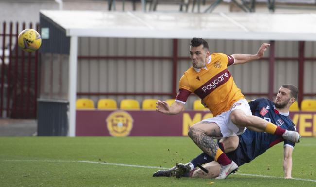 Tony Watt prods the ball home to make it 1-0 to Motherwell