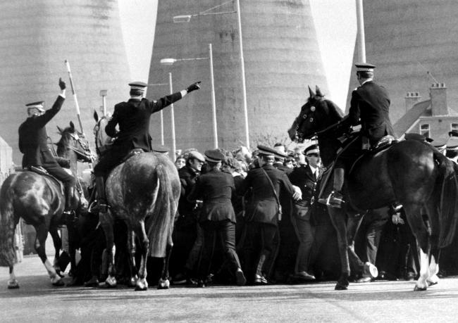 Police horses move in on pickets as coal lorries enter Ravenscraig, 1984