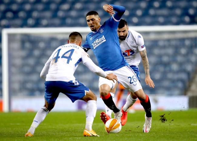 Rangers' Leon Balogun (centre) and Lech Poznan's Alan Czerwinski (left) battle for the ball during the UEFA Europa League match at Ibrox