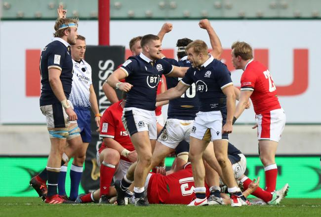 James Lang (second left) celebrates with Scott Steele after the referee awards the late penalty to Scotland