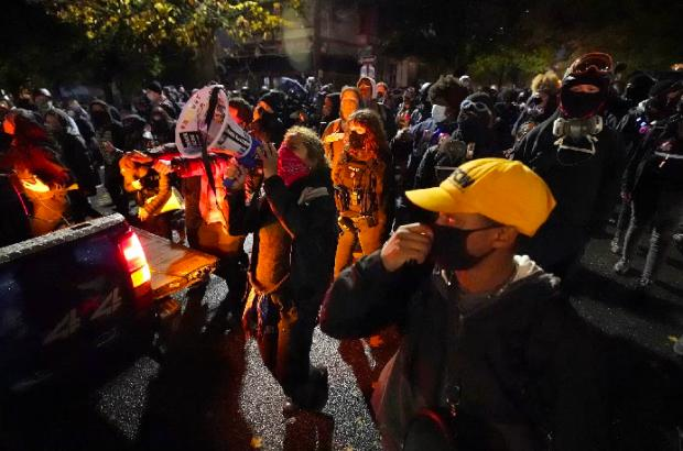 HeraldScotland: Protesters march in Portland (Photo: AP)