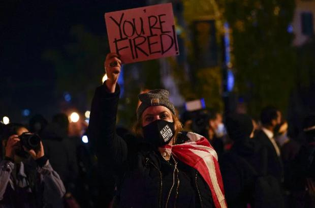 HeraldScotland: A protester in Washington (Photo: AP)