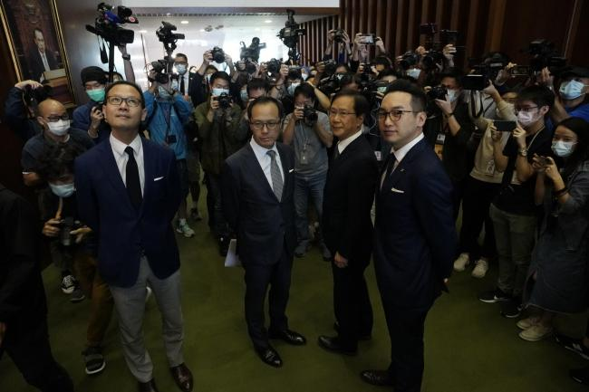 Four lawmakers, from left, Dennis Kwok, Kenneth Leung, Kwok Ka-ki and Alvin Yeung pose after a news conference at Legislative Council in Hong Kong, Wednesday, Nov. 11, 2020. Hong Kong has moved to disqualify the four pro-democracy legislators, after Beiji