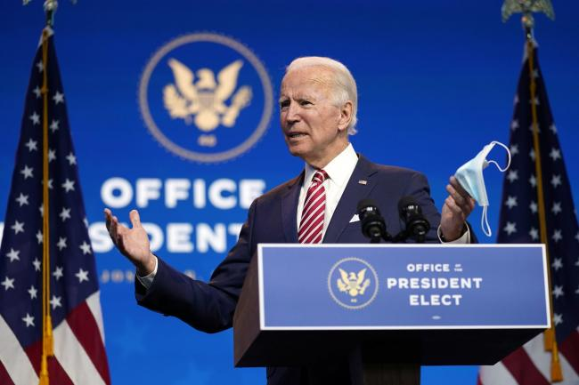 President-elect Joe Biden speaks about economic recovery at The Queen Theatre on Monday, Nov. 16, 2020, in Wilmington, Del. (AP Photo/Andrew Harnik).