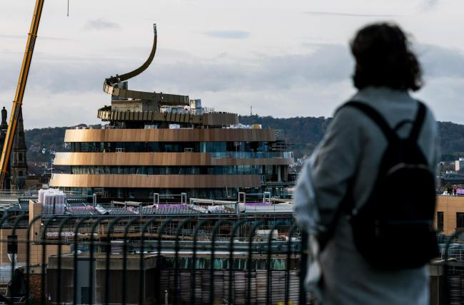 Milestone in build of controversial 'ribbon hotel' as 'final flourish' added to Edinburgh's skyline