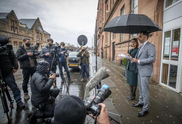 HeraldScotland: Lawyer Aamer Anwar, alongside Libyan Consultant Ferial El Ayeb (left), delivers a statement to the media in Glasgow ahead of an appeal against the conviction of Abdelbaset al-Megrahi for the Lockerbie bombing at the High Court of Justiciary in Edinburgh.