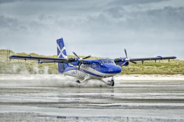 HeraldScotland: A Twin Otter aircraft, operated by Loganair, at Traigh Mhor beach on Barra. Picture: Jamie Simpson/The Herald