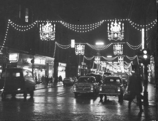 Traffic in Buchanan Street in Glasgow passes under the Christmas illuninations.